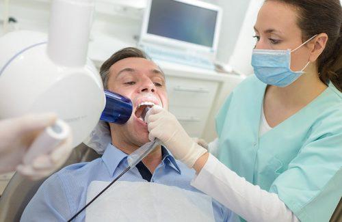 dentist-doing-digital-xray-in-dentist-office-PEYMCLT.jpg